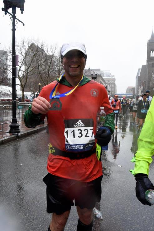 Duane Brown with his Boston Marathon medal