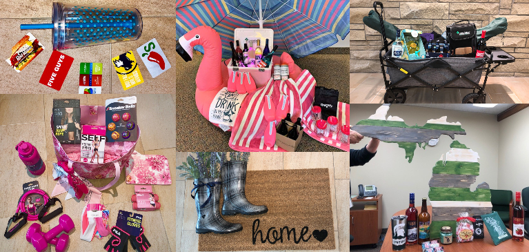 Employees created baskets for a raffle fundraiser at GreemStone with gift cards, pink work out equipment, homeade gifts, floor mats, beach umbrella and pink large flamingo filled with alcoholic drinks for the lake, wooden michigan sign and wagon with camping gear