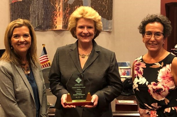 Senator Debbie Stabenow receives award, Friend of Farm Credit and is pictured with Christine Cumbraugh and Laura Braun