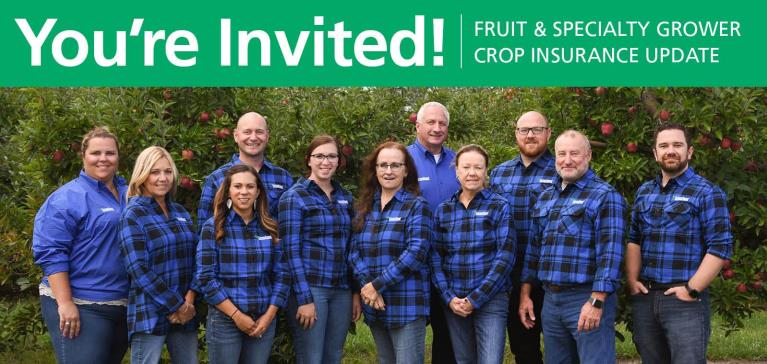 GreenStone's experienced team of fruit and specialty crop insurance stand in a group in a customer orchard in late summer with blossoming apple trees behind them.