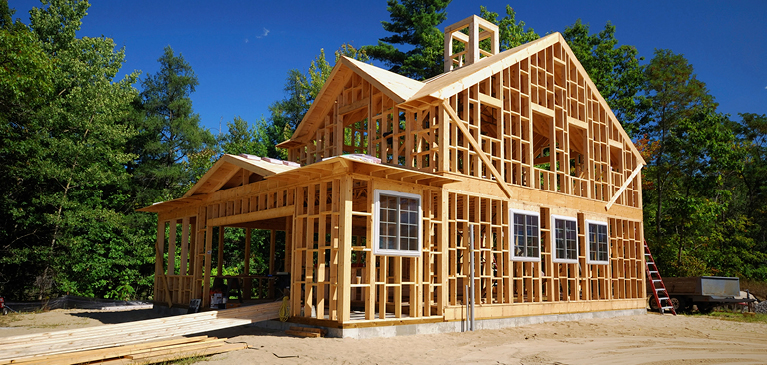 Home construction in a wooded area