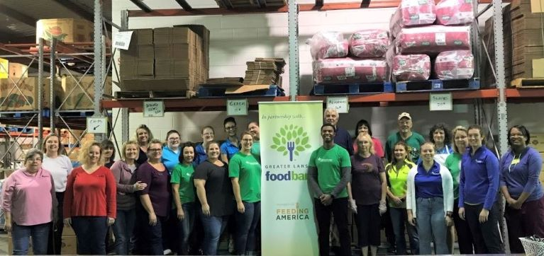 GreenStone legal services team volunteering together at the Greater Lansing Food Bank.