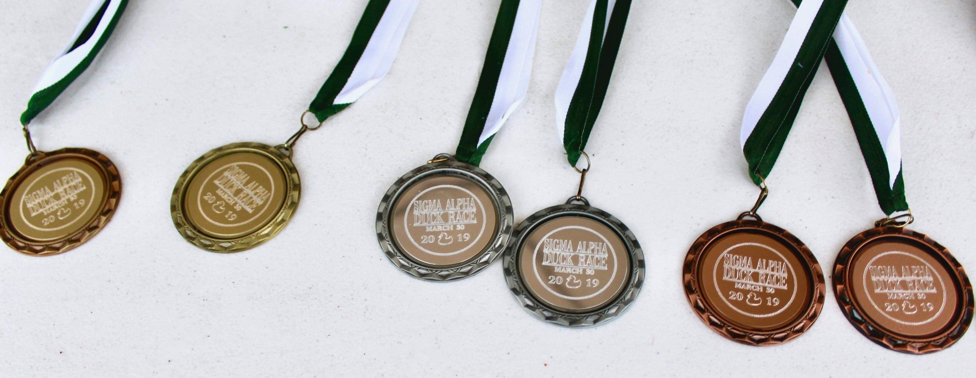 Sigma Alpha 5K Duck Race Medals