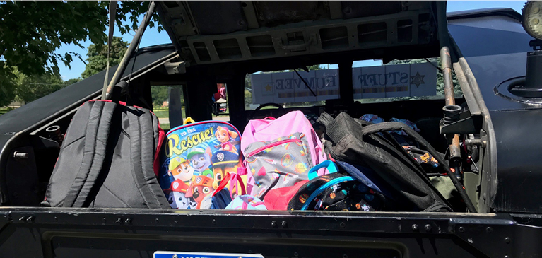 A Humvee stuffed with back to school supplies