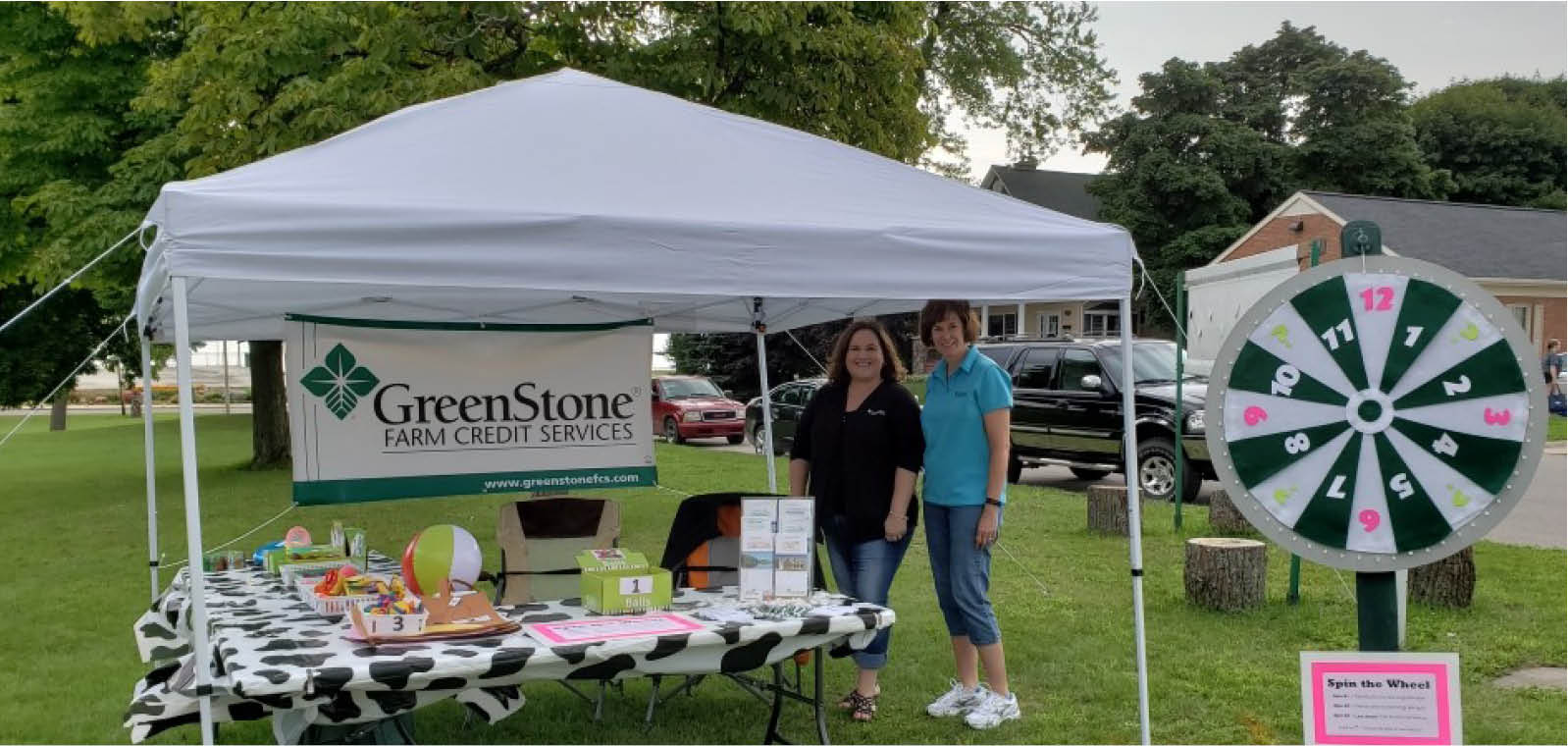 Two women outside GreenStone tent at AgVenture Day
