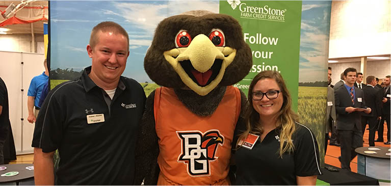 Two young GreenStone employees with the Bowling Green State University mascot