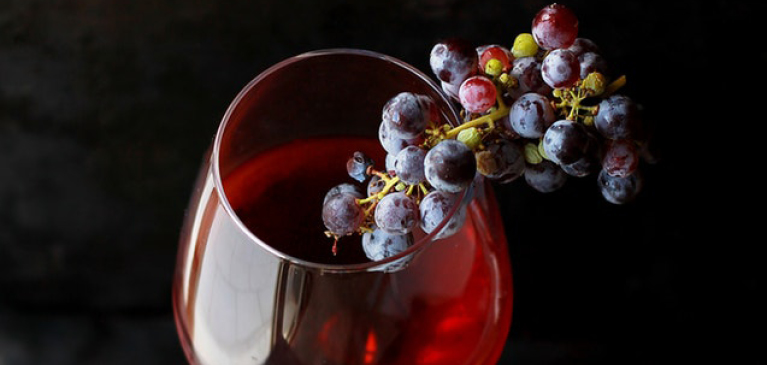 Grapes in a glass of wine